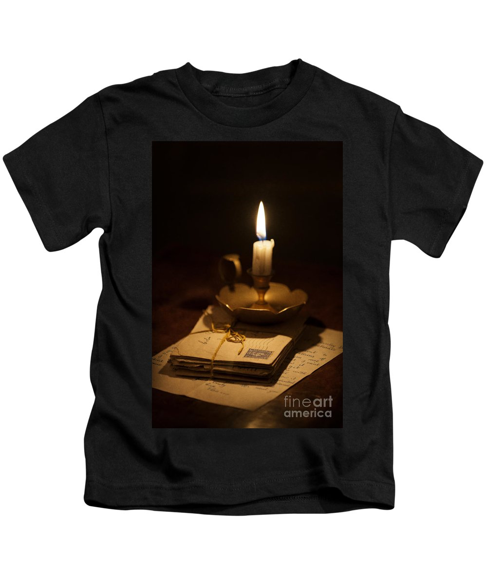 Candle Kids T-Shirt featuring the photograph Bundle Of Letters By Candle Light by Lee Avison