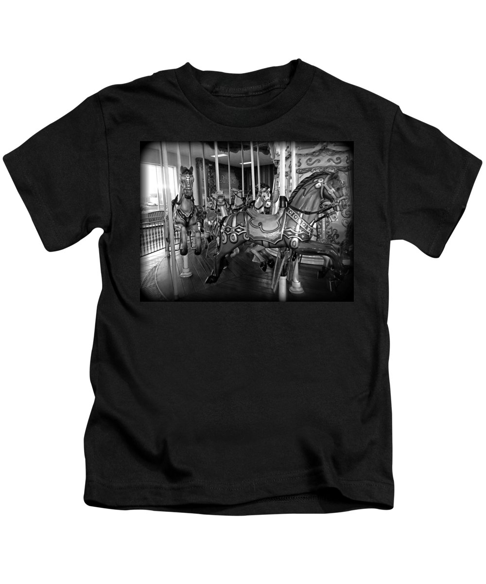 Carousel Kids T-Shirt featuring the photograph Carousel Horses In Black And White by Alice Gipson