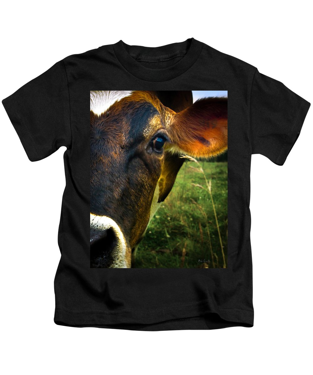 Cows Kids T-Shirt featuring the photograph Cow Eating Grass by Bob Orsillo