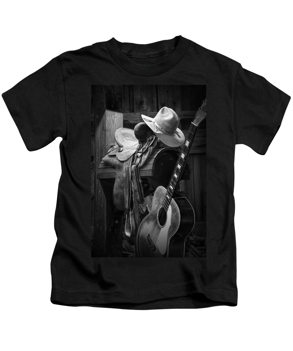 Landscape Kids T-Shirt featuring the photograph Cowboy Acoustic Guitar by Randall Nyhof