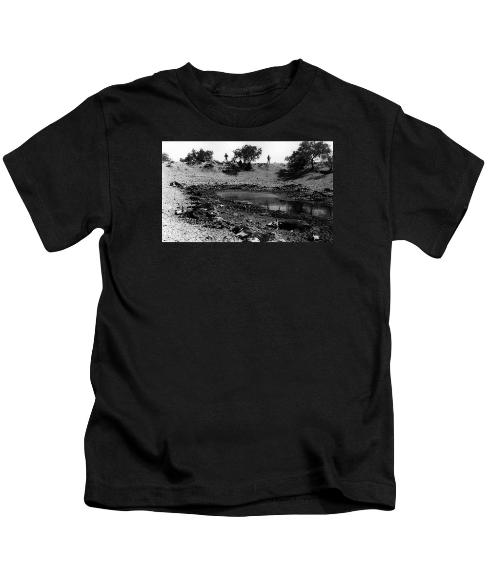 Dead Cattle Contaminated Water Hole Once In 100 Year's Drought Near Sells Arizona Tohono O'odham Reservation 1969 Ted Degrazia Kids T-Shirt featuring the photograph Dead Cattle Contaminated Water Hole Once In 100 Year's Drought Near Sells Arizona Tohono O'odham by David Lee Guss