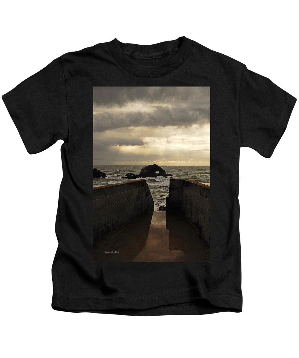 Clouds Kids T-Shirt featuring the photograph Eye Of The Storm by Donna Blackhall