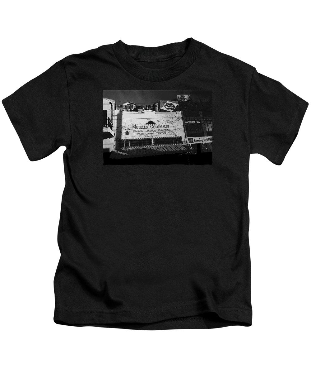 Film Noir Robert Mitchum Where Danger Lives 1950 1 Border Town Nogales Sonora Mexico Kids T-Shirt featuring the photograph Film Noir Robert Mitchum Where Danger Lives 1950 1 Border Town Nogales Sonora Mexico by David Lee Guss