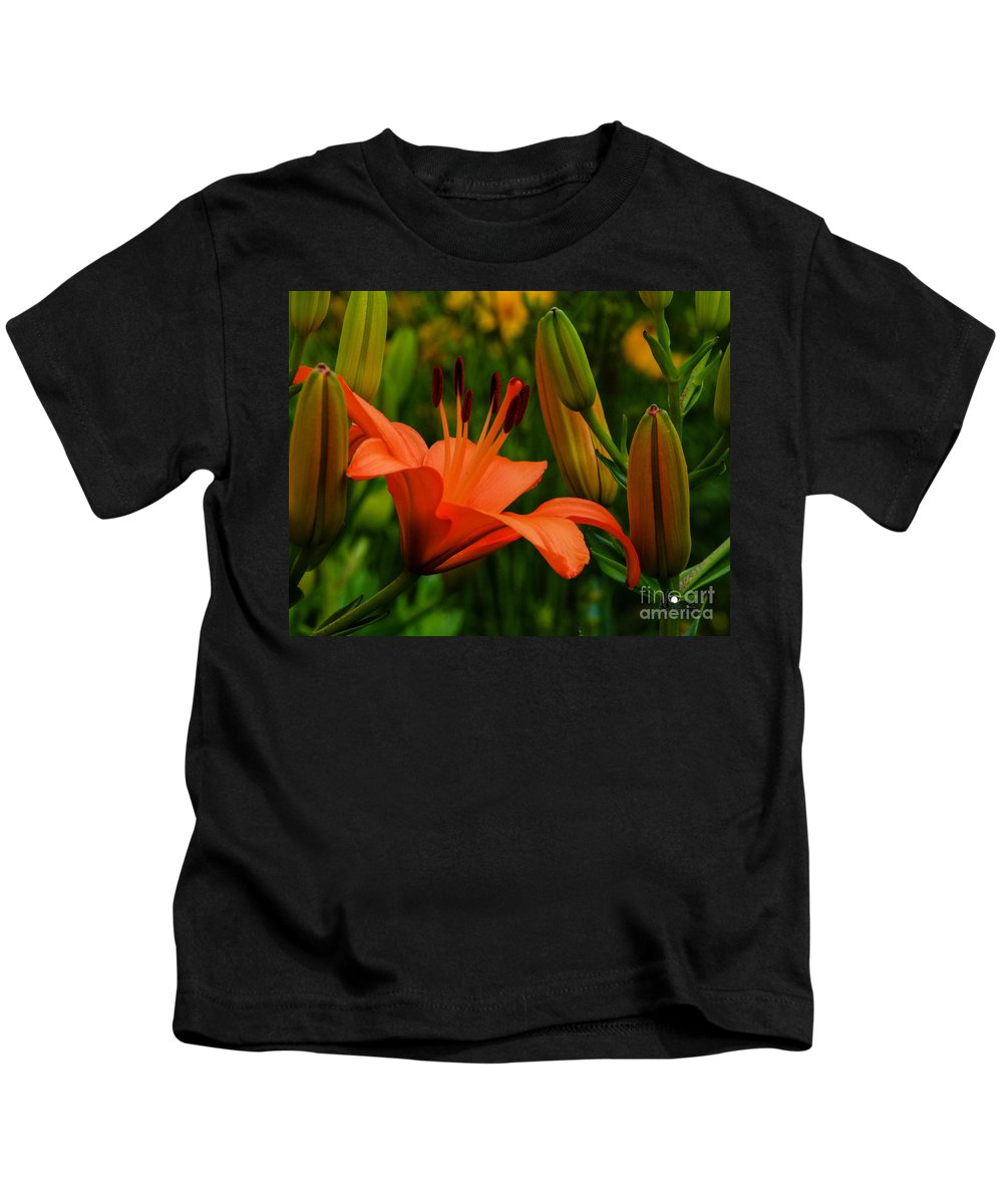 Tiger Lilly Kids T-Shirt featuring the photograph First To Bloom by Grace Grogan