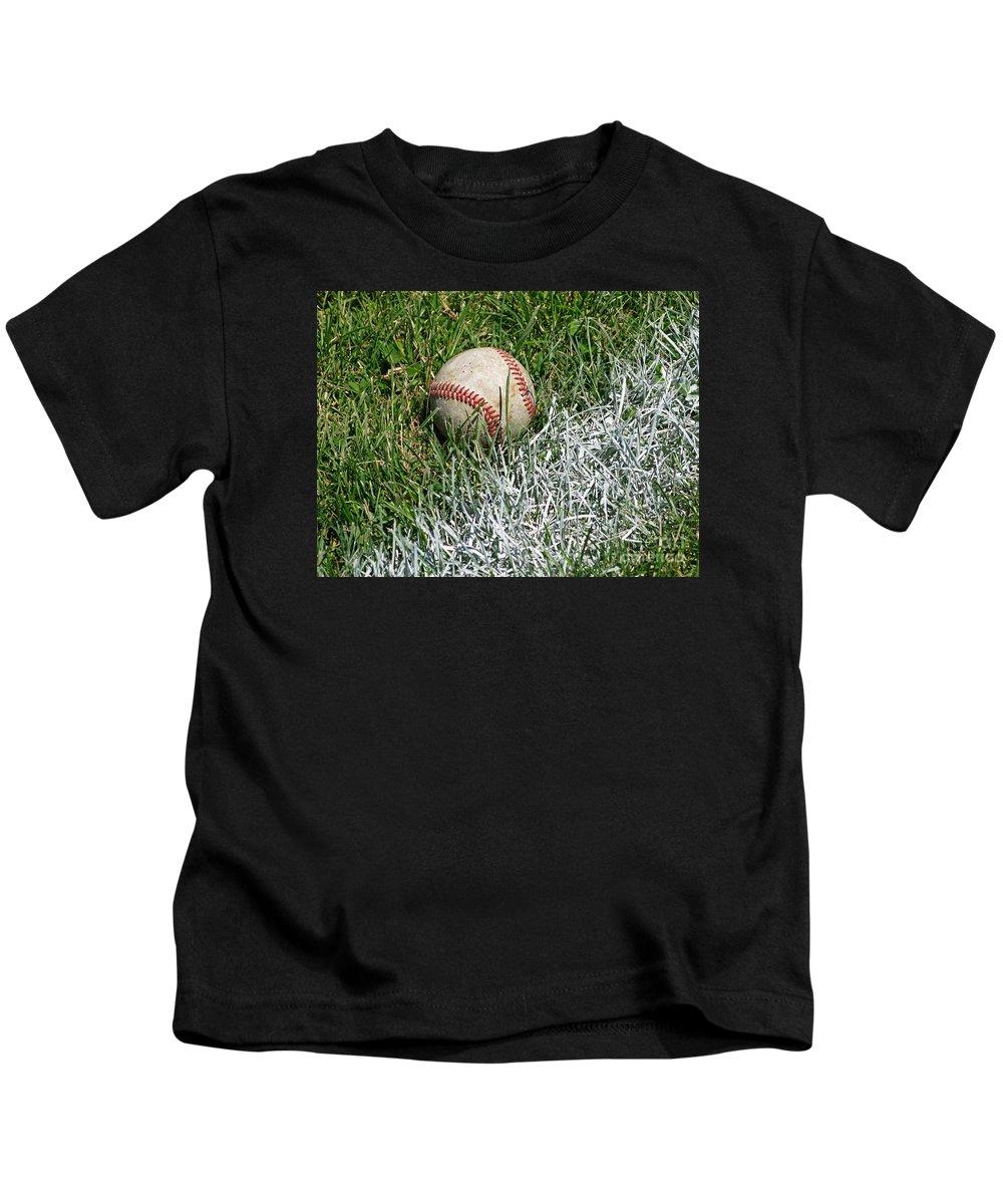 Baseball Kids T-Shirt featuring the photograph Foul Ball by Ann Horn