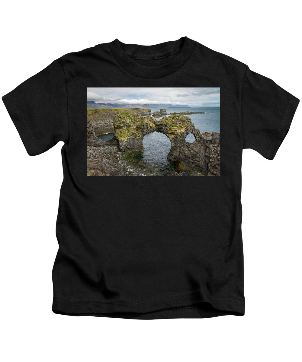 Iceland Kids T-Shirt featuring the photograph Gatklettur Arch In Hellnar by For Ninety One Days
