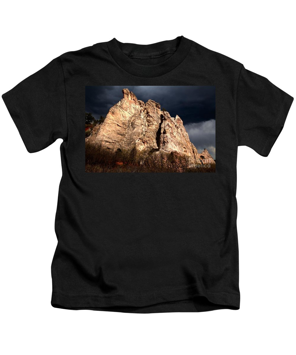 Garden Of The Gods Kids T-Shirt featuring the photograph Glowing Under Storm Clouds by Adam Jewell