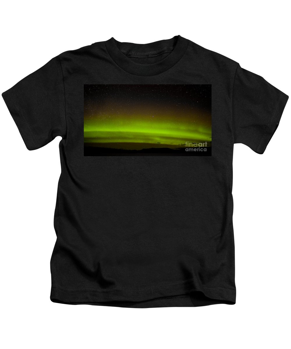 Above Kids T-Shirt featuring the photograph Green Northern Lights And Myriad Of Stars by Stephan Pietzko