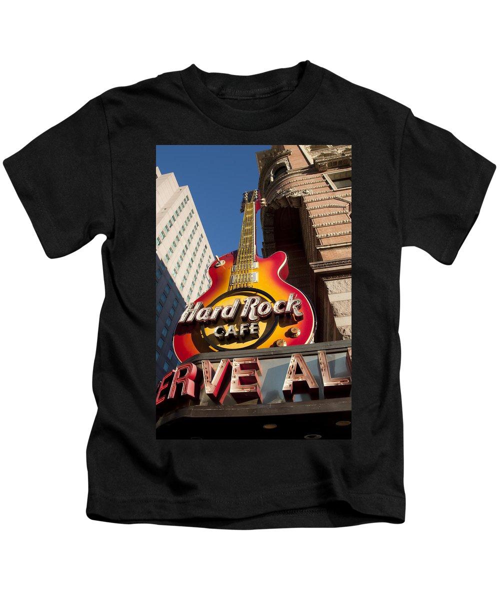 Hard Rock Cafe Guitar Sign In Philadelphia Kids T-Shirt featuring the photograph Hard Rock Cafe Guitar Sign In Philadelphia by Bill Cannon