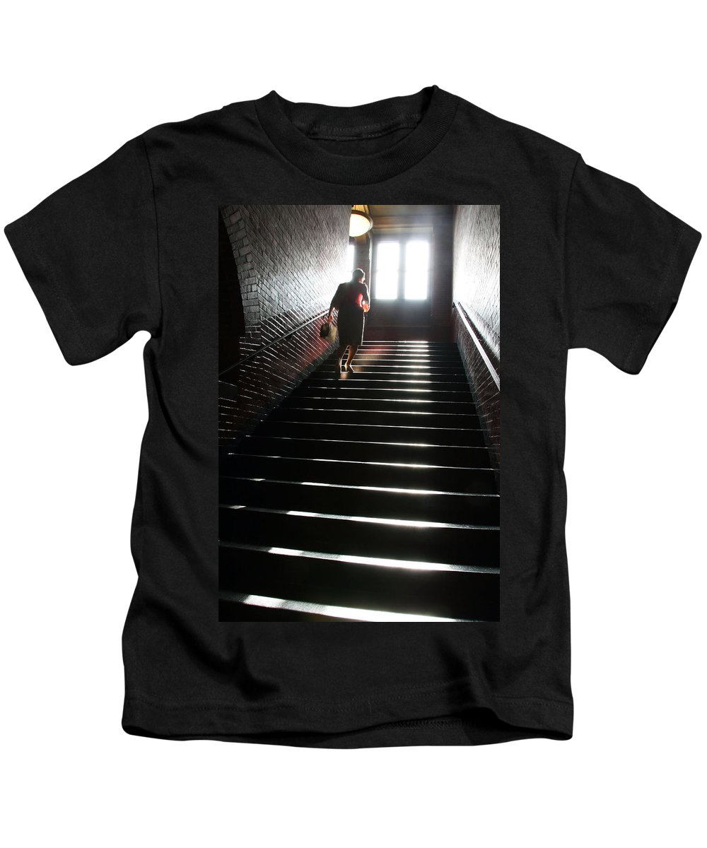 Woman Kids T-Shirt featuring the photograph In A Stairwell by Cora Wandel