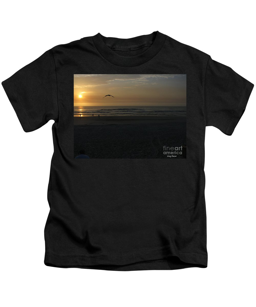 Florida Sunrise Kids T-Shirt featuring the photograph It Starts by Greg Patzer