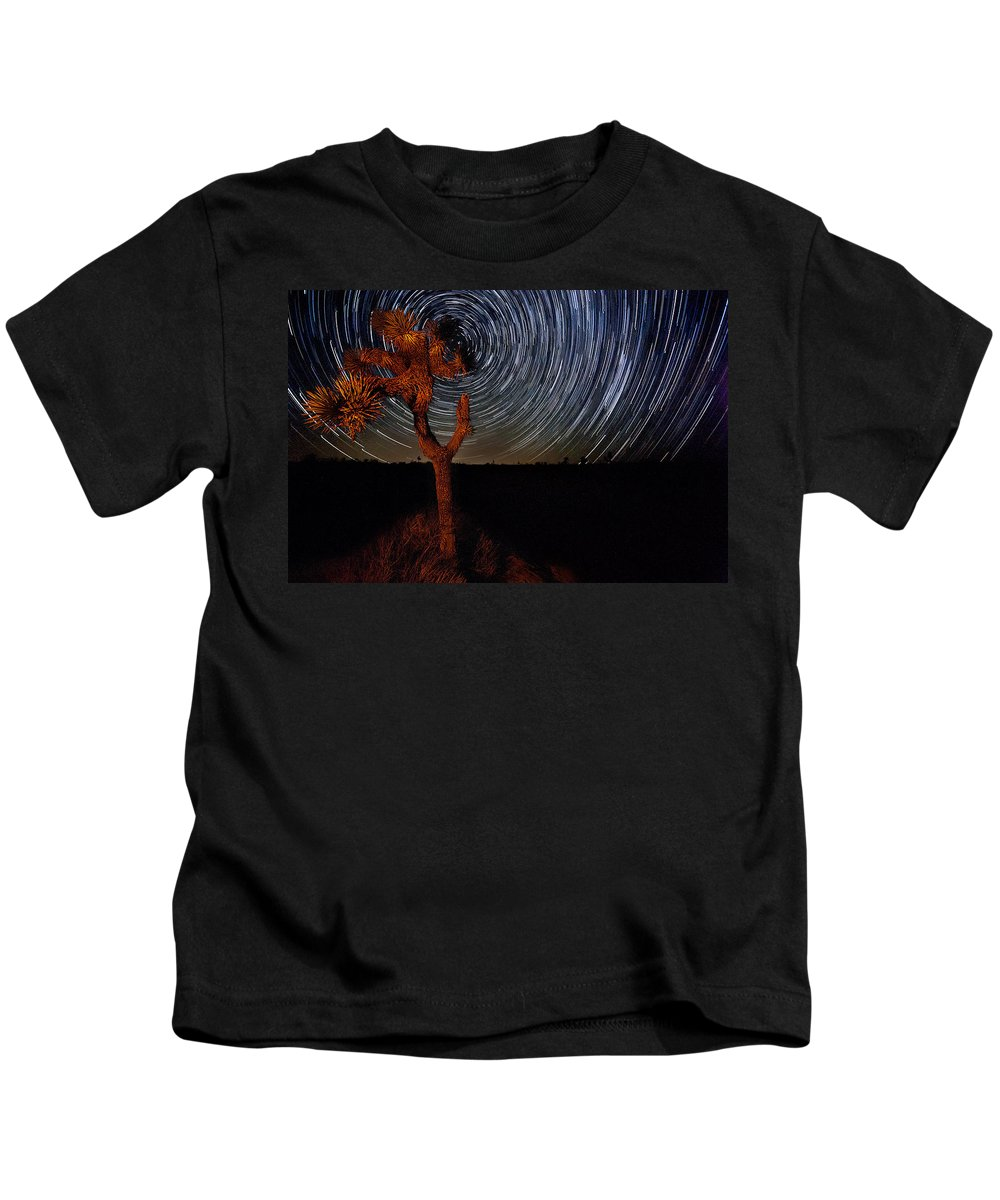 Big Sky Kids T-Shirt featuring the photograph Joshua Tree Star Trails by Peter Tellone