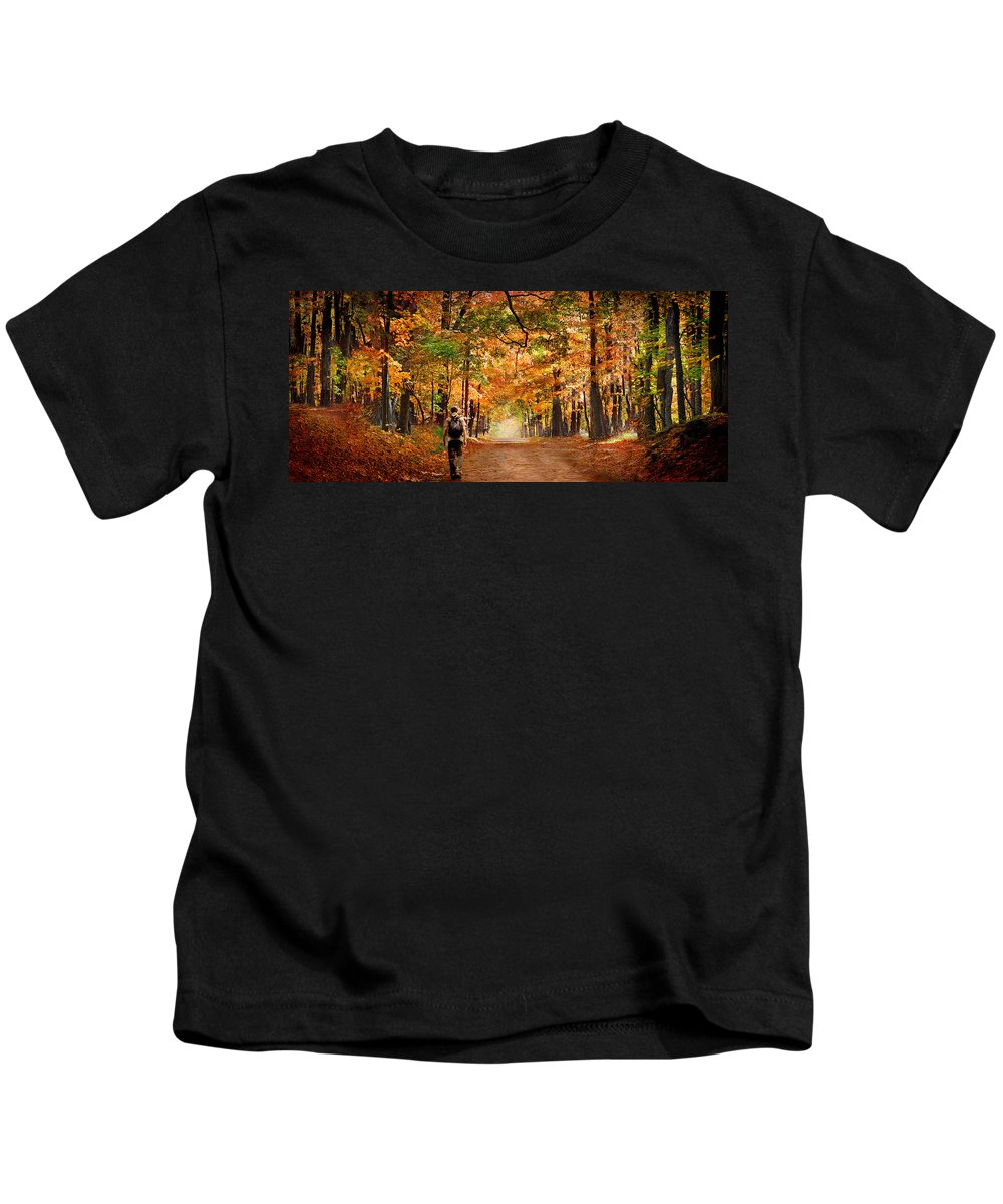 Photography Kids T-Shirt featuring the photograph Kid With Backpack Walking In Fall Colors by Panoramic Images