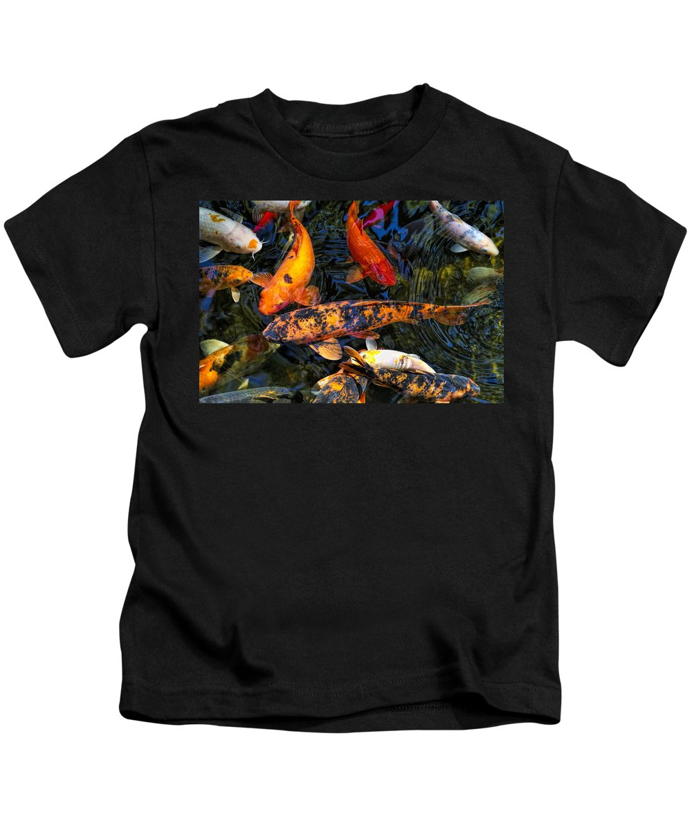 Cyprinus Carpio Haematopterus Kids T-Shirt featuring the photograph Koi Magic by Kathy Clark