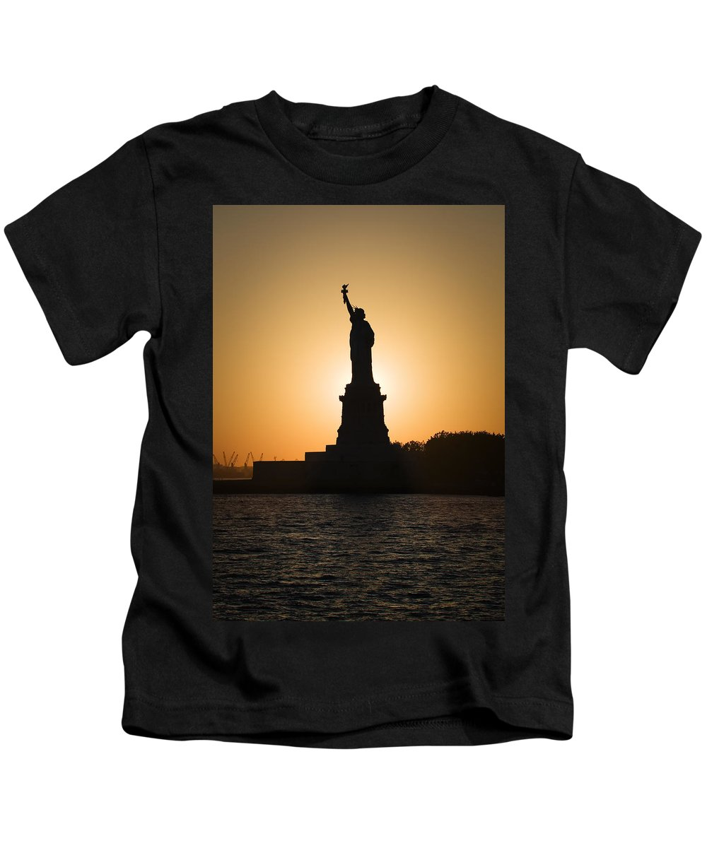 Statue Of Liberty Kids T-Shirt featuring the photograph Liberty Sunset by Dave Bowman