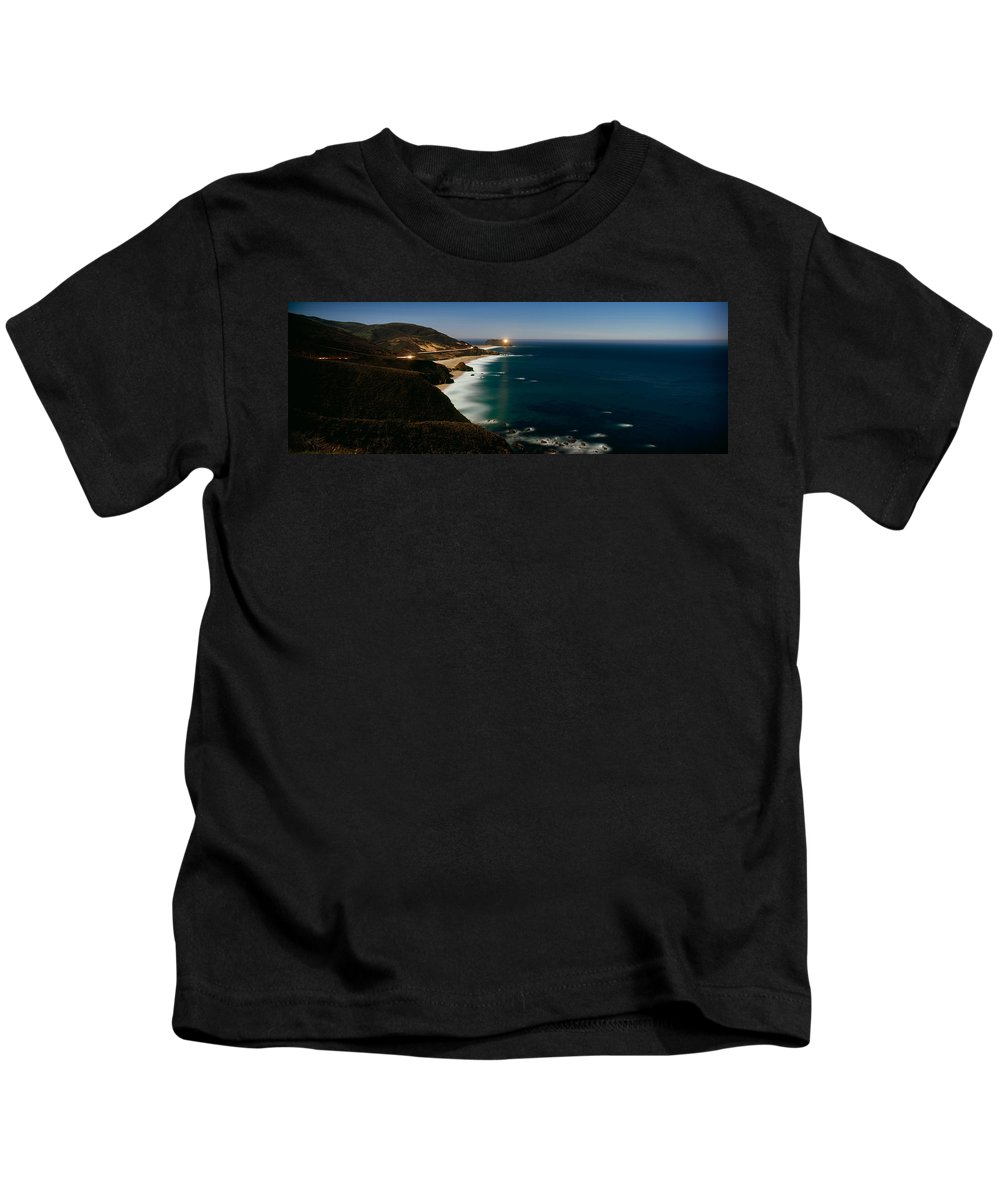 Photography Kids T-Shirt featuring the photograph Lighthouse At The Coast, Moonlight by Panoramic Images