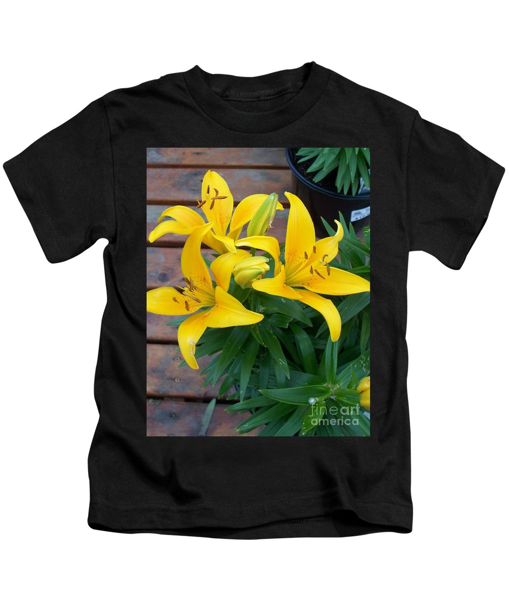 Photograph Kids T-Shirt featuring the photograph Lily Yellow Flower by Eric Schiabor