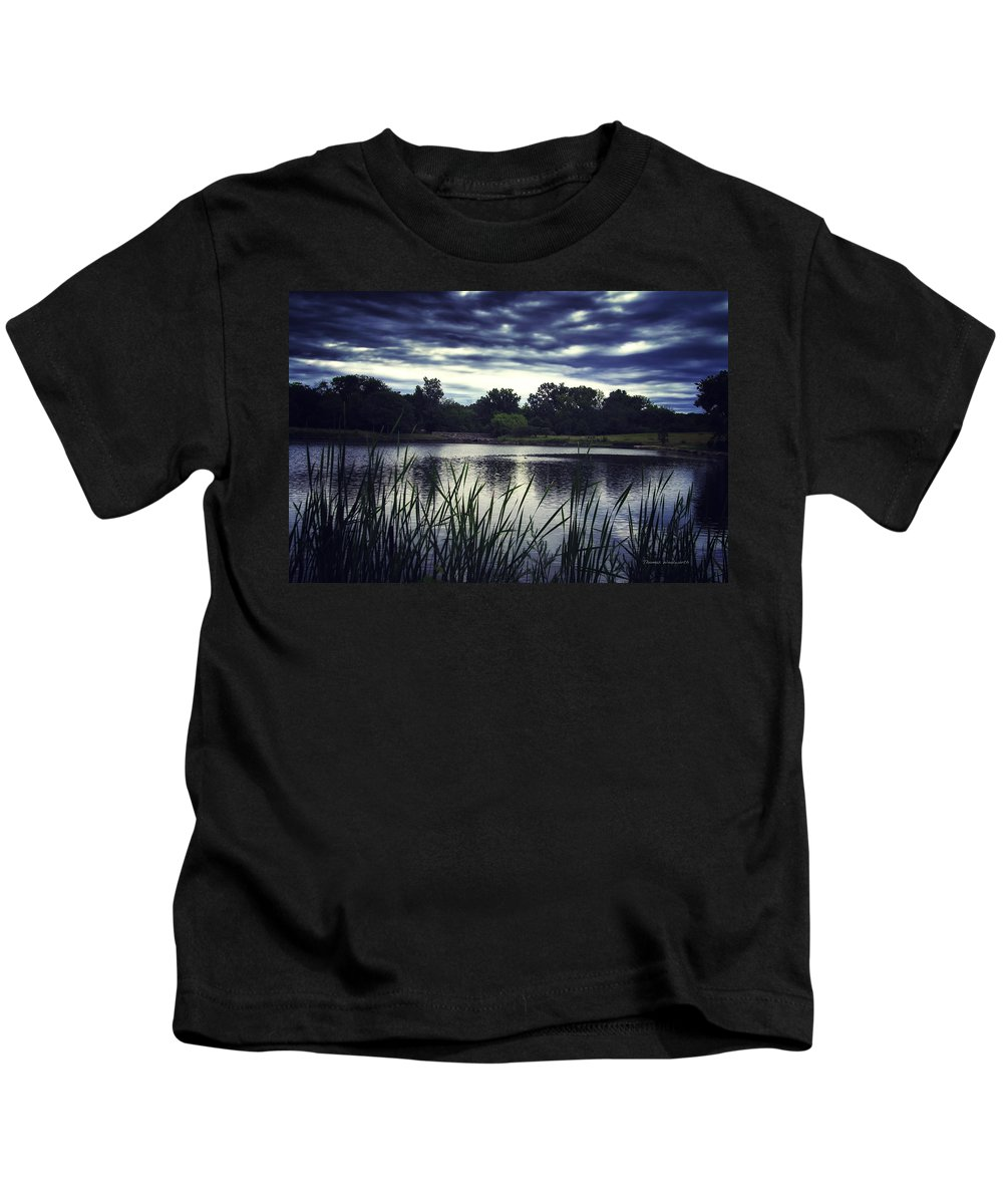 Storm Kids T-Shirt featuring the photograph Lone Duck At Dusk by Thomas Woolworth