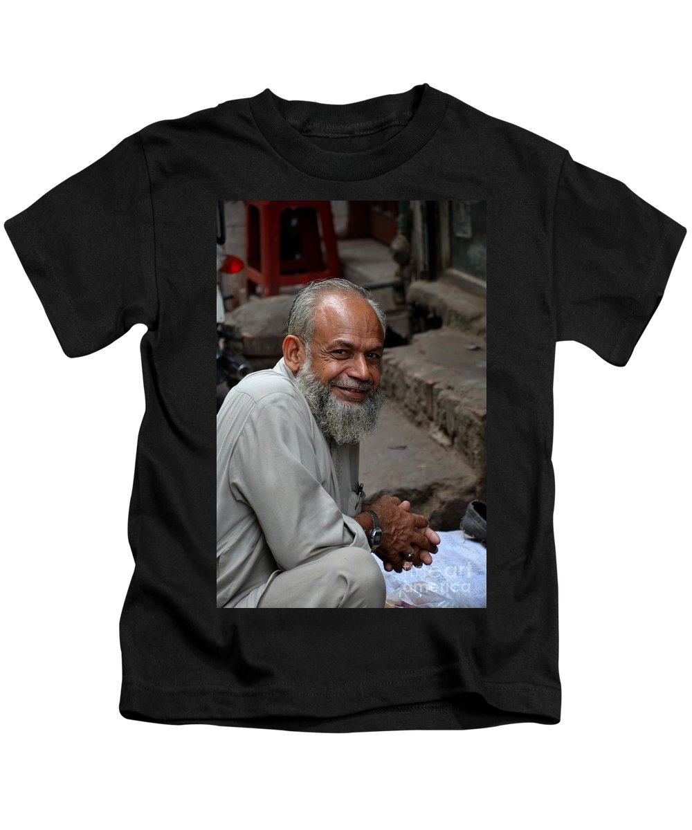 Man Kids T-Shirt featuring the photograph Man Smiles For Camera Lahore Pakistan by Imran Ahmed