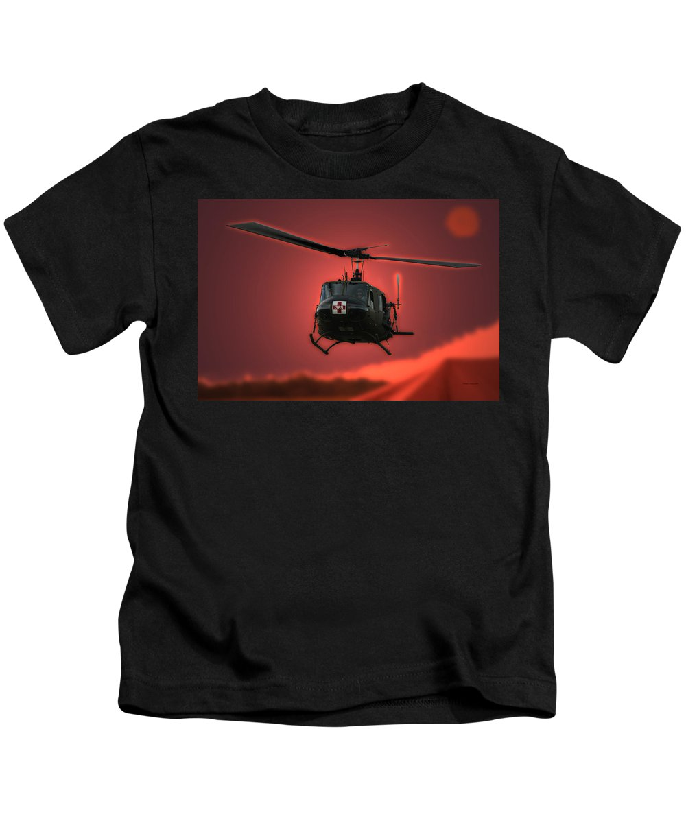 Dust Off Kids T-Shirt featuring the photograph Medevac The Sound Of Hope by Thomas Woolworth