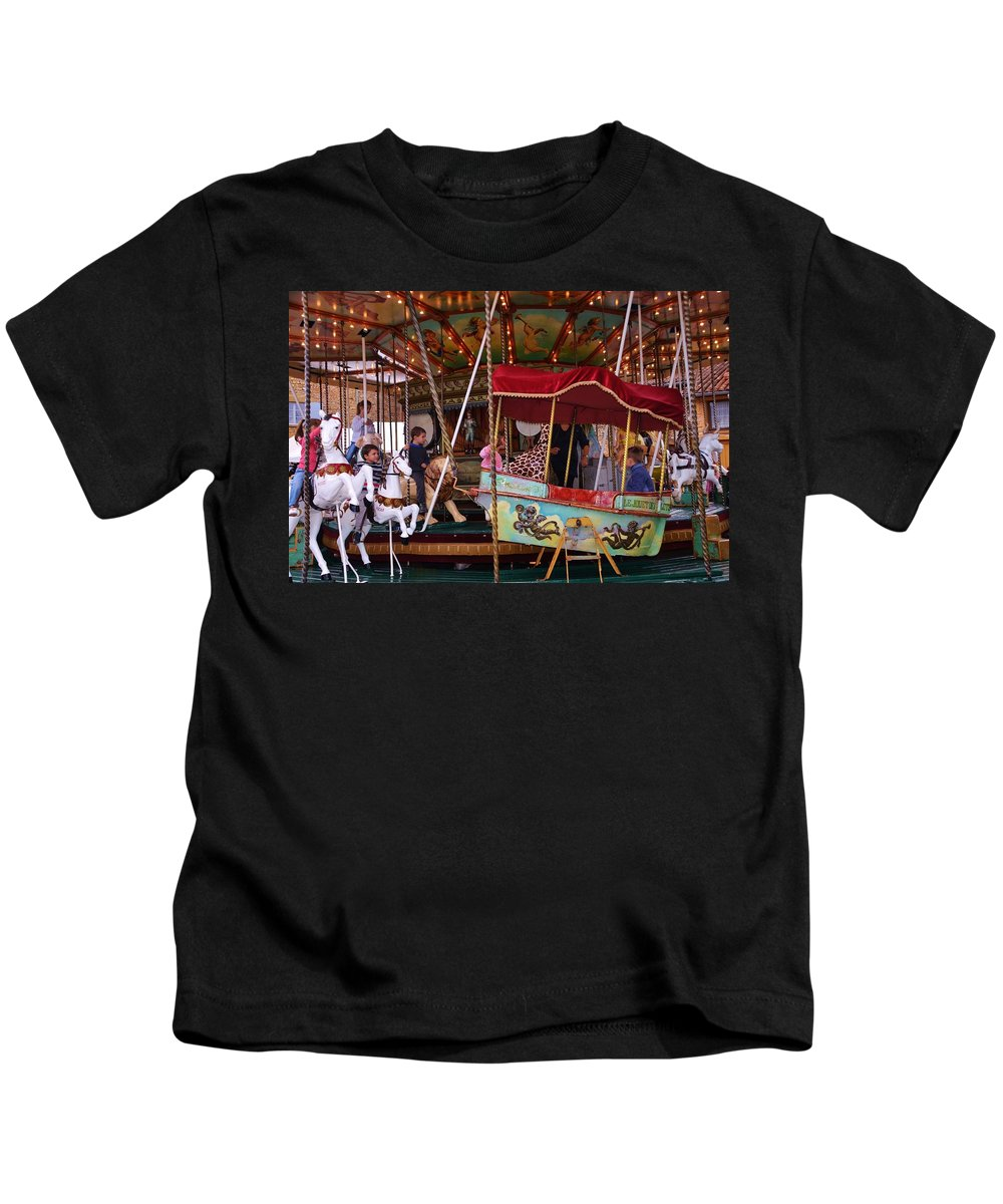 Amusement Kids T-Shirt featuring the photograph Merry Go Round by Dany Lison