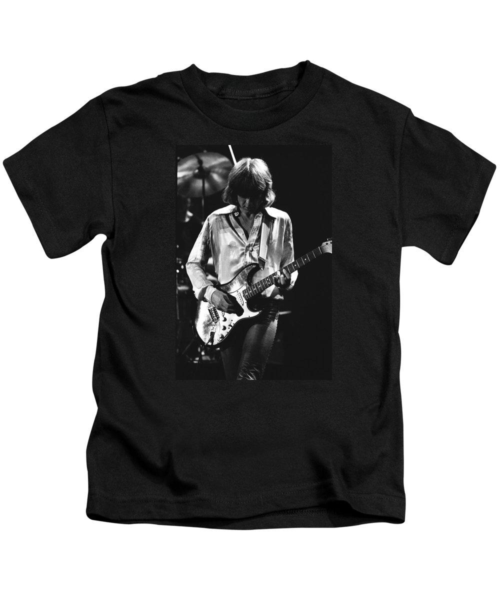 Mick Ralphs Kids T-Shirt featuring the photograph Mick On Guitar 1977 by Ben Upham