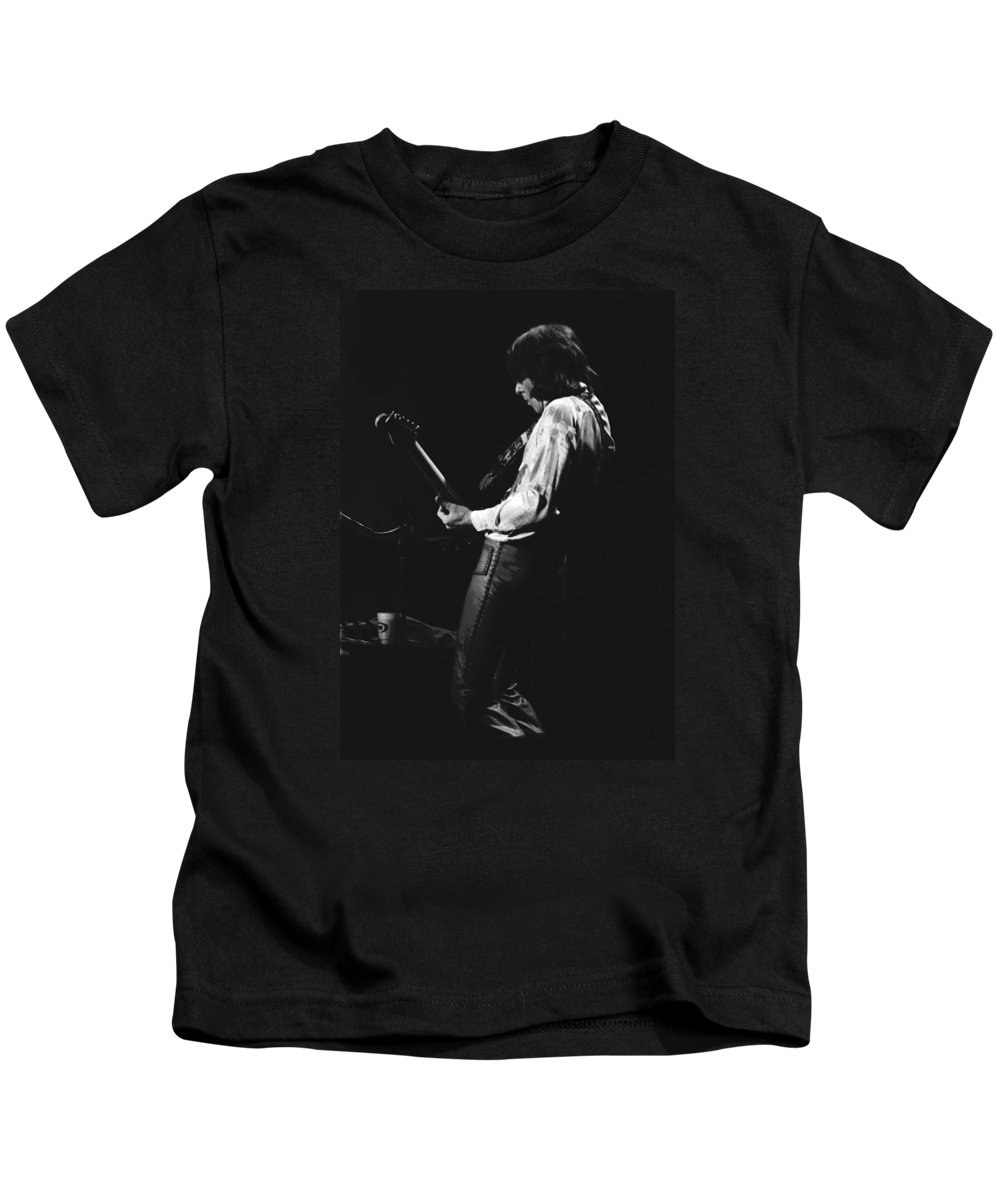 Mick Ralphs Kids T-Shirt featuring the photograph Mick On The Guitar 1977 by Ben Upham