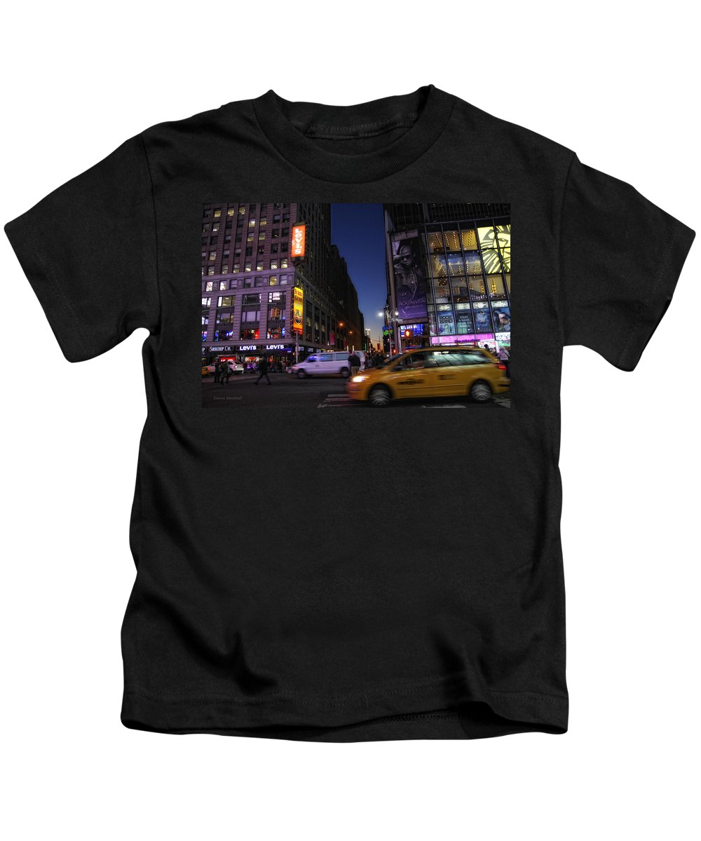 New York City Kids T-Shirt featuring the photograph Never Sleeps by Donna Blackhall