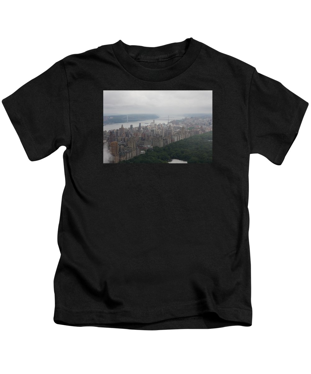 New York Kids T-Shirt featuring the photograph New York City Syline Draped In Clouds by Christiane Schulze Art And Photography