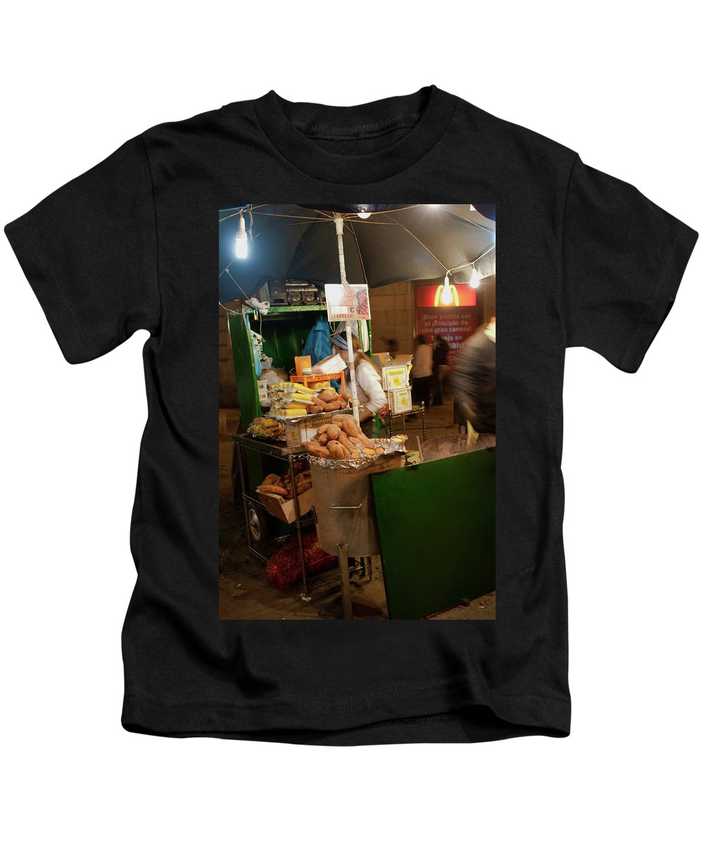 Madrid Kids T-Shirt featuring the photograph Nighttime Vendor by Lorraine Devon Wilke