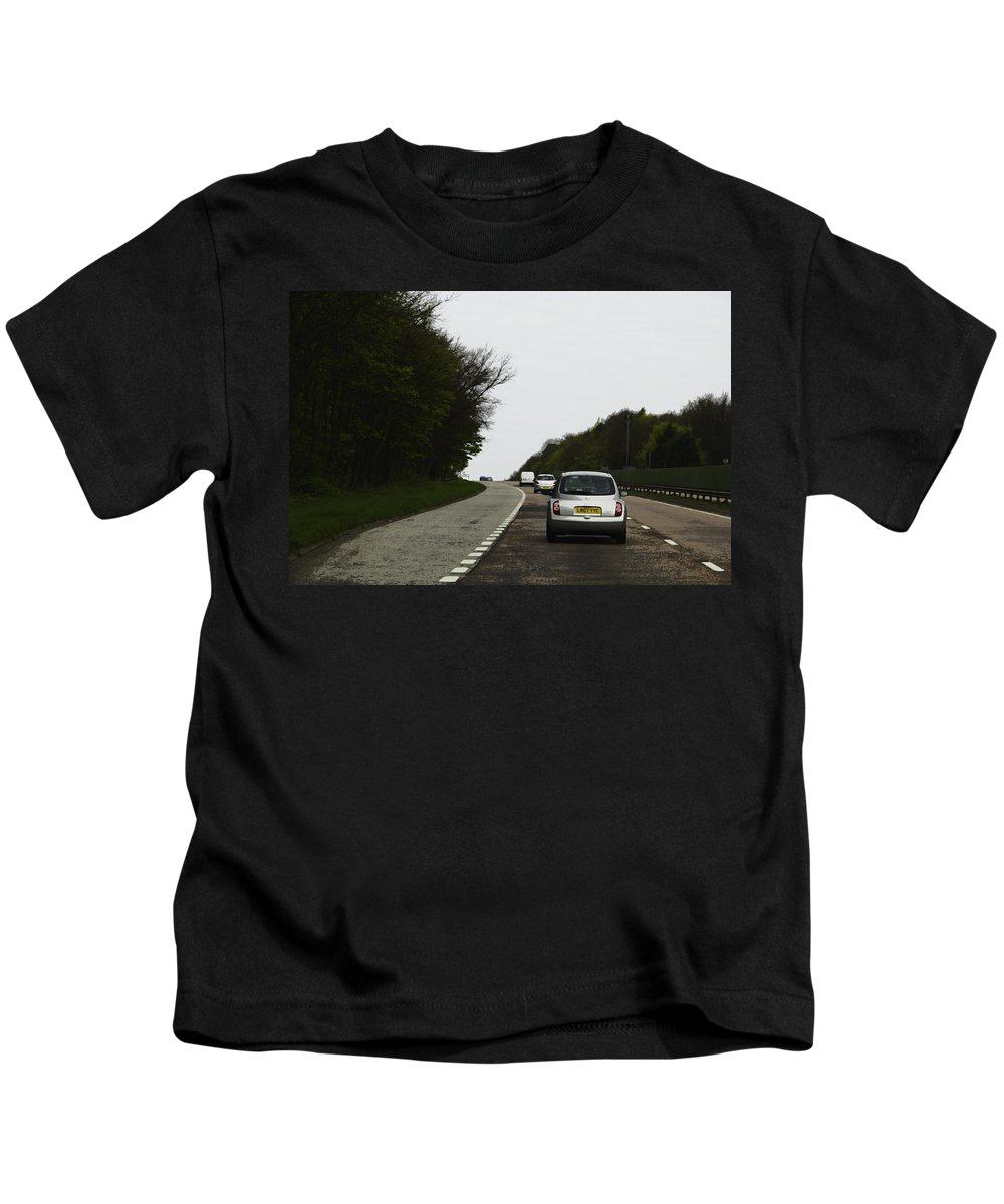 Canon Kids T-Shirt featuring the digital art Oil Painting - Nissan Micra On The Streets Of Scotland With Greenery On Both Sides by Ashish Agarwal