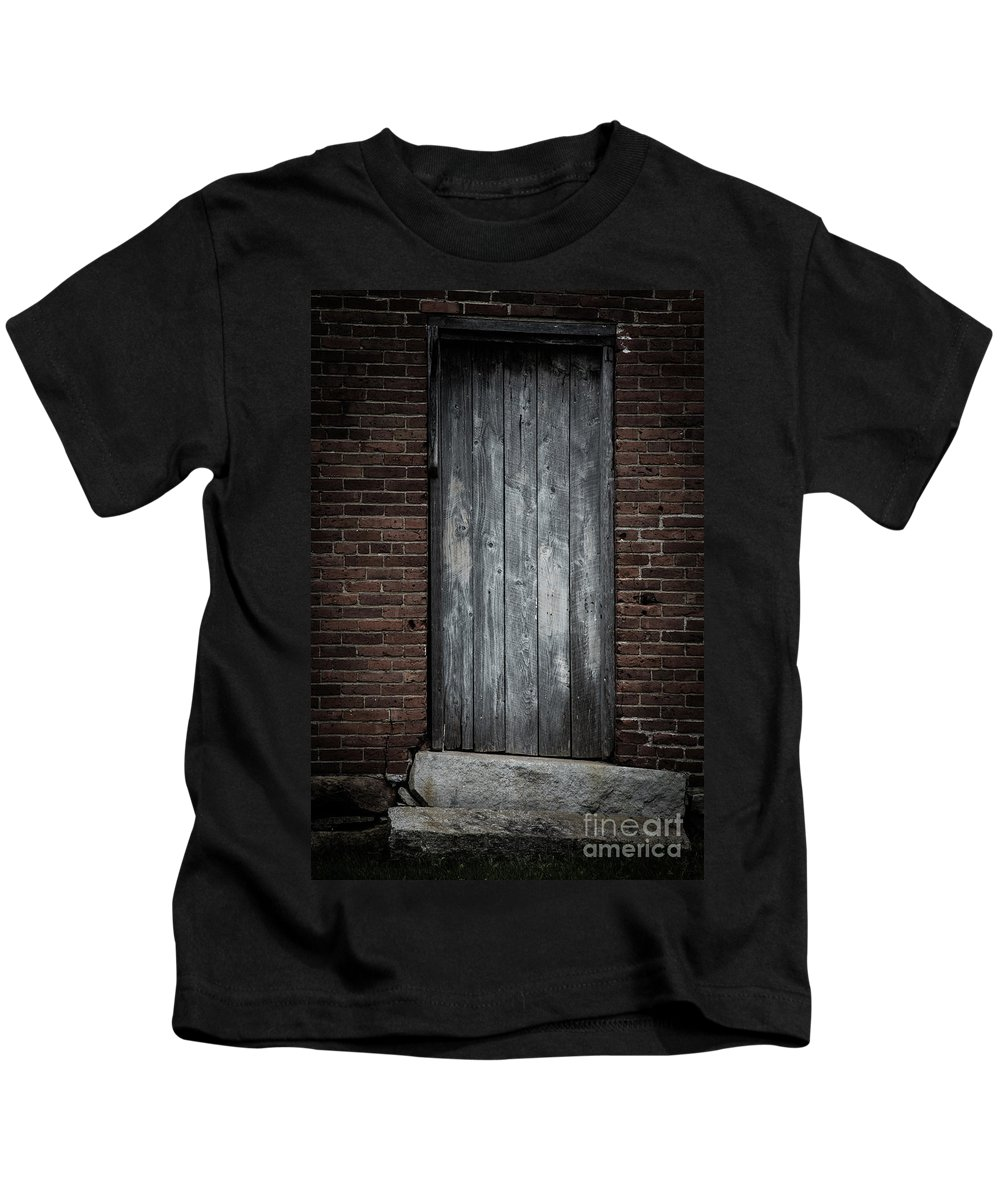 Door Kids T-Shirt featuring the photograph Old Blacksmith Shop Door by Edward Fielding