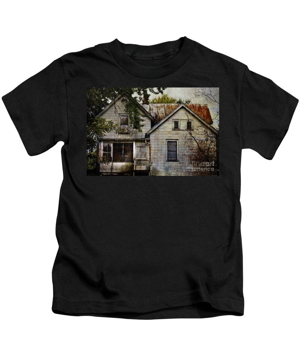 Abandoned; Home; House; Old; Farmhouse; Spooky; Peeling Paint; Derelict; Neglected; Sidewalk; Creepy; Dark; Entrance; Stairs; Door; Haunted; Porch; Eerie; Scary; Ruin; Mood; Gloomy; Rural Kids T-Shirt featuring the photograph Once Lived In by Margie Hurwich