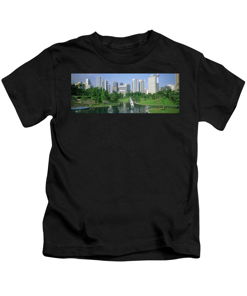 Photography Kids T-Shirt featuring the photograph Park In The City, Petronas Twin Towers by Panoramic Images