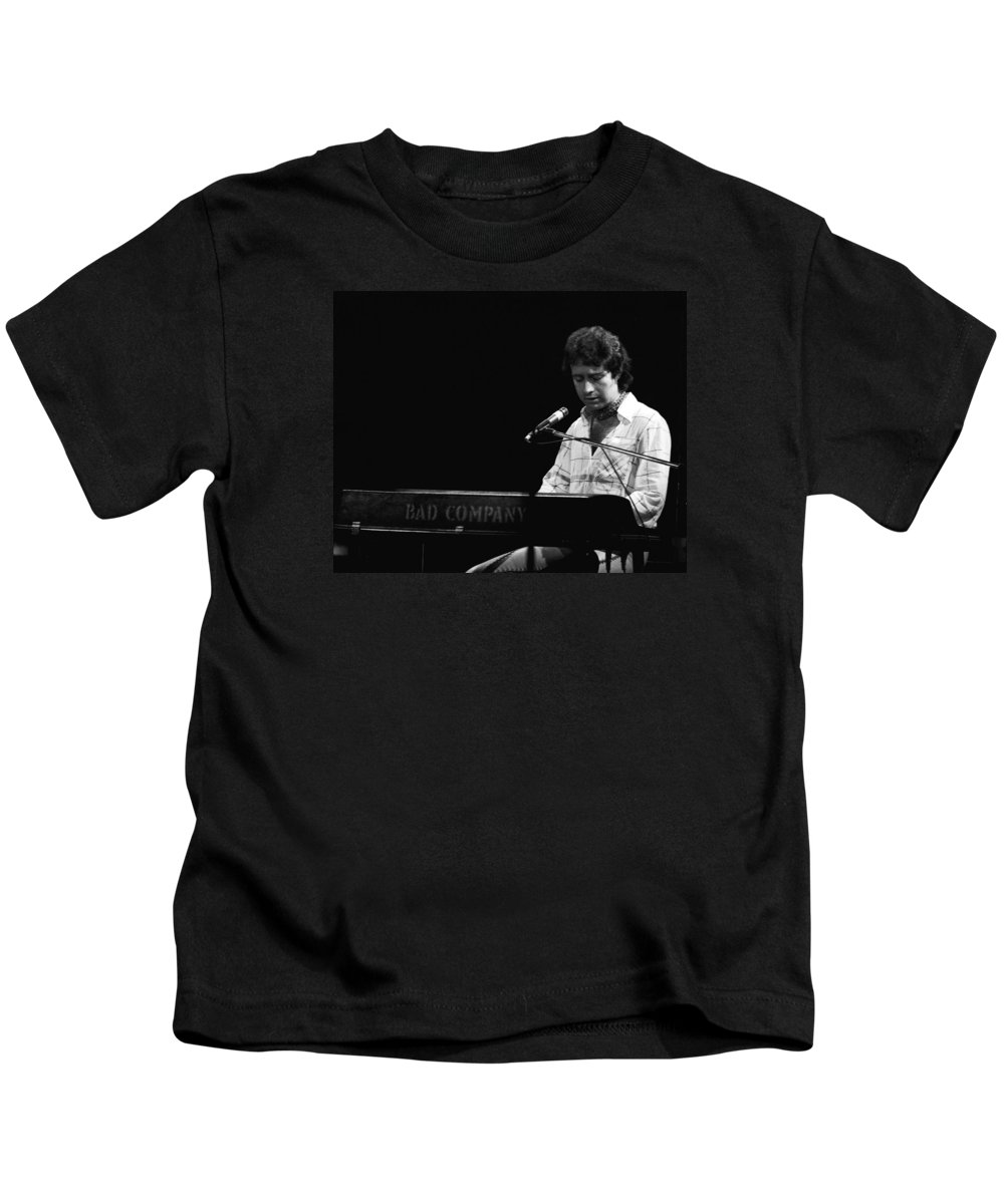 Paul Rodgers Kids T-Shirt featuring the photograph Paul At The Keyboard In Spokane 1977 by Ben Upham