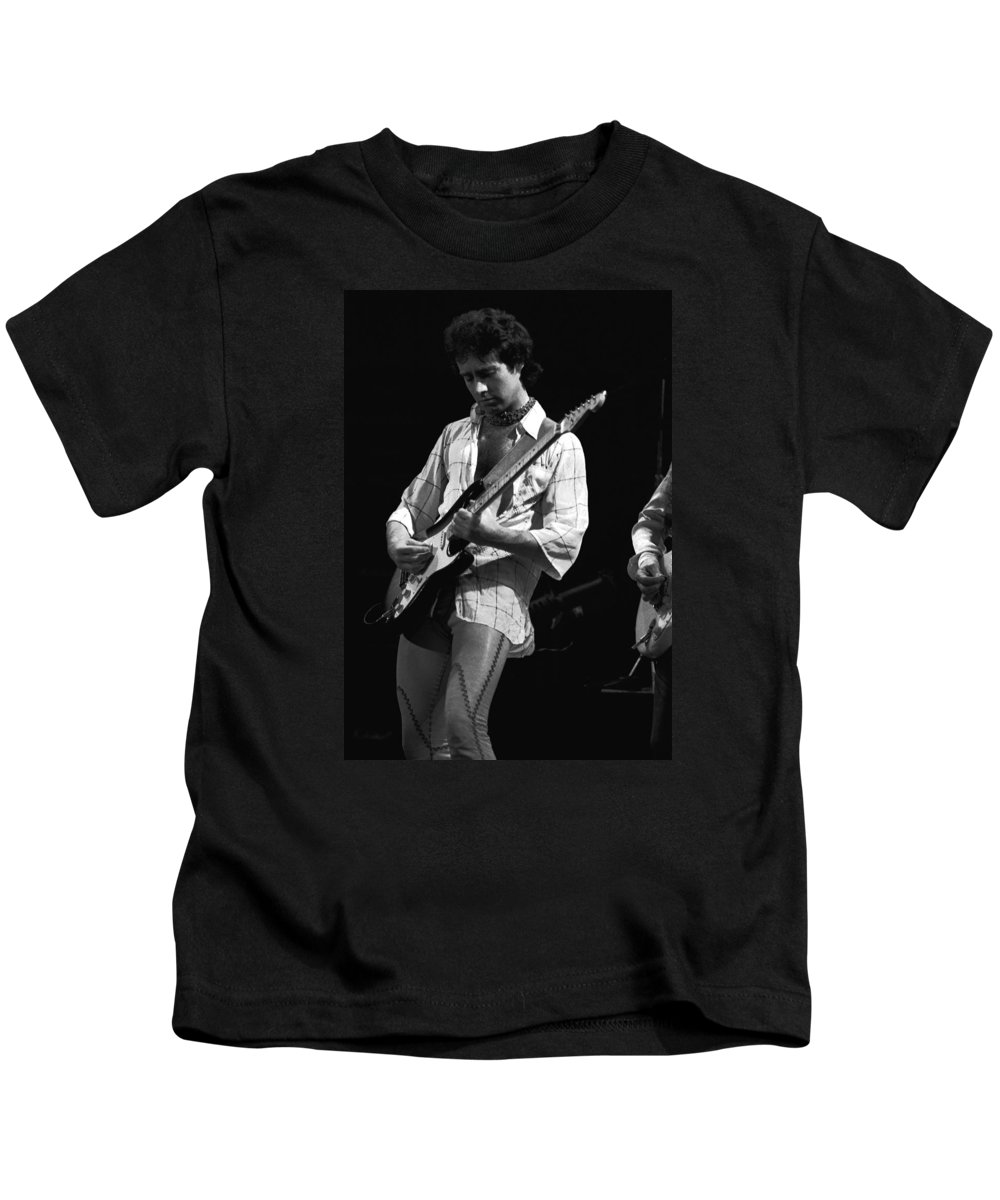 Paul Rodgers Kids T-Shirt featuring the photograph Paul At Work On His Guitar In 1977 by Ben Upham