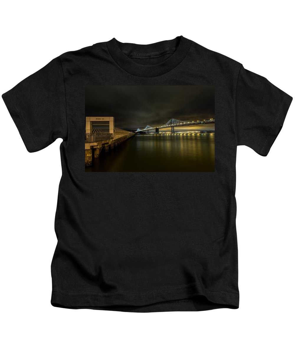 San Francisco Kids T-Shirt featuring the photograph Pier 14 And Bay Bridge At Night by John Daly