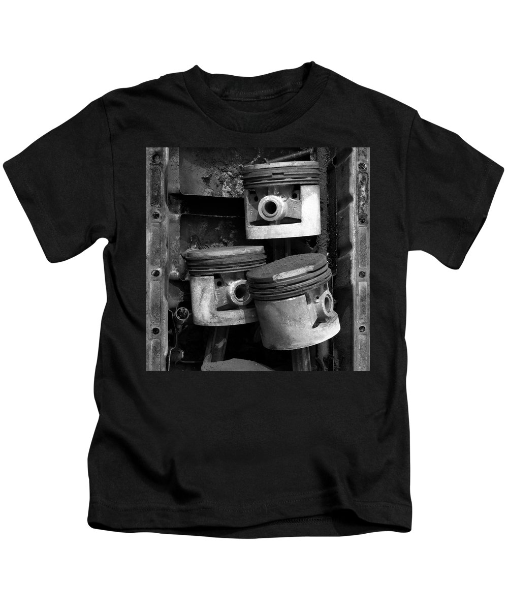 Vehicles Kids T-Shirt featuring the photograph Pisotons in a Pan by Paul DeRocker