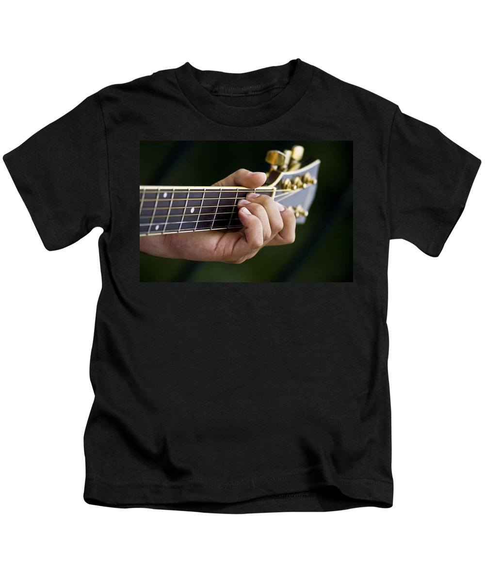 Instrument Kids T-Shirt featuring the photograph Playing Guitar by Paulo Goncalves