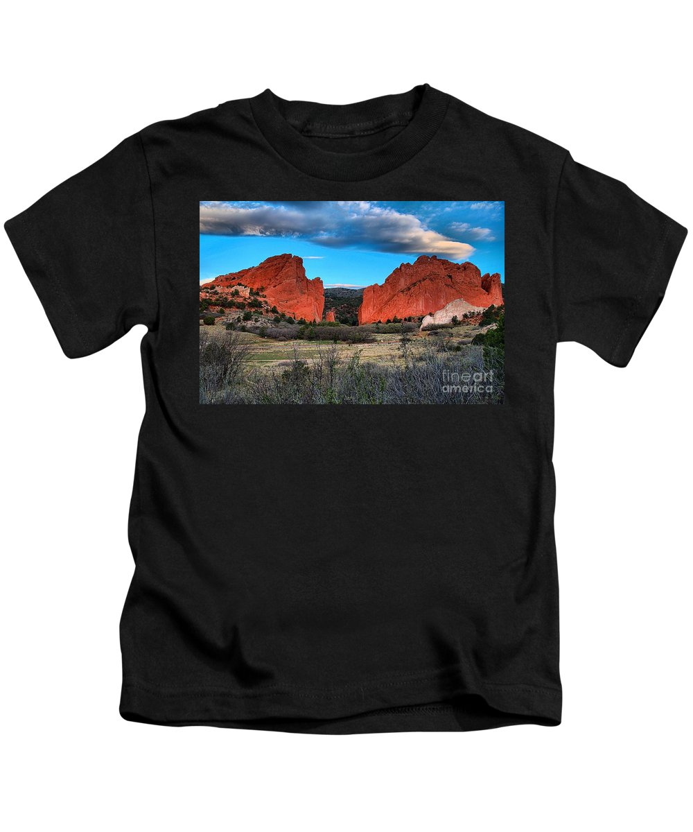 Sunrise At Garden Of The Gods Kids T-Shirt featuring the photograph Red Rocks At Sunrise by Adam Jewell