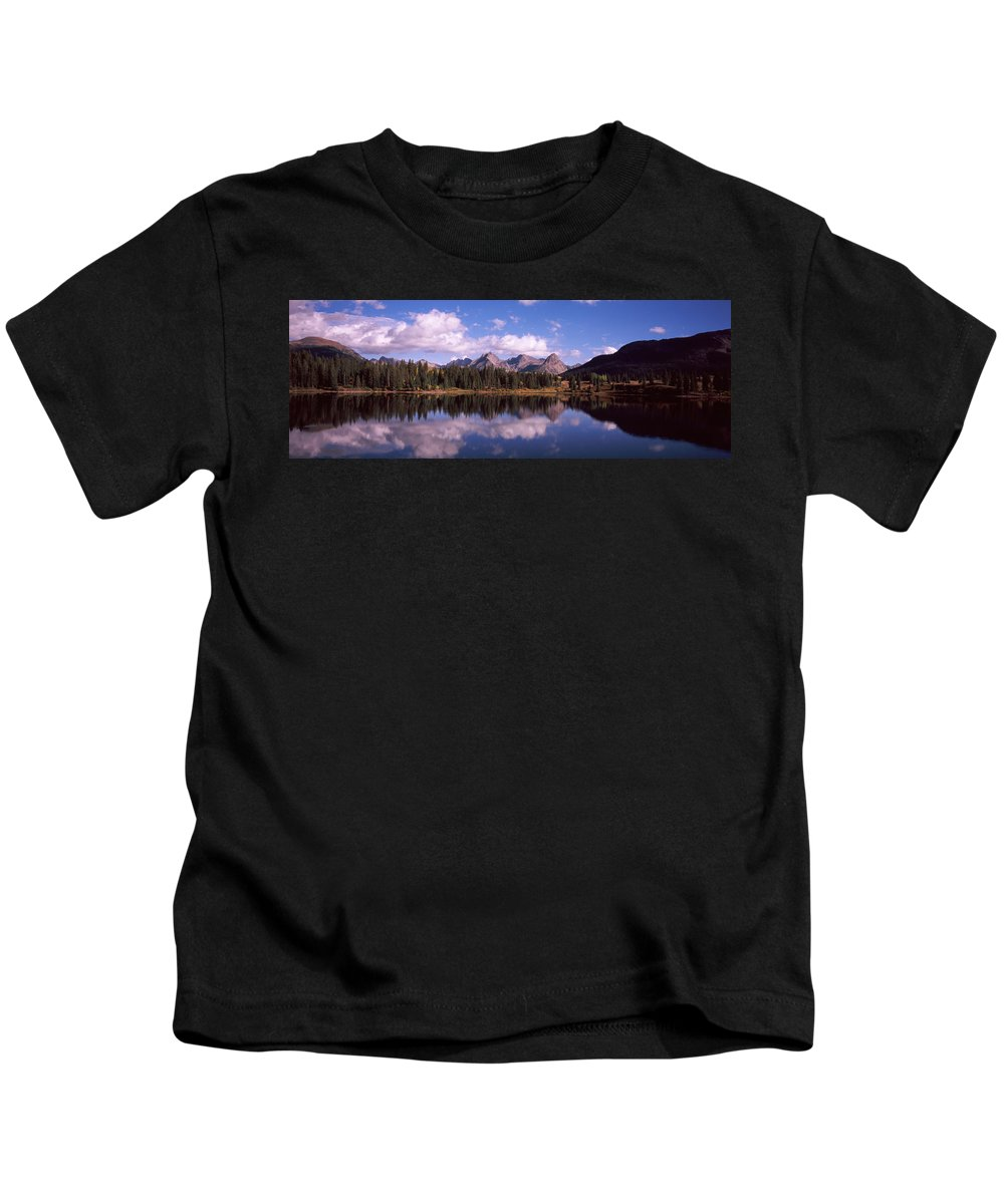Photography Kids T-Shirt featuring the photograph Reflection Of Trees And Clouds by Panoramic Images