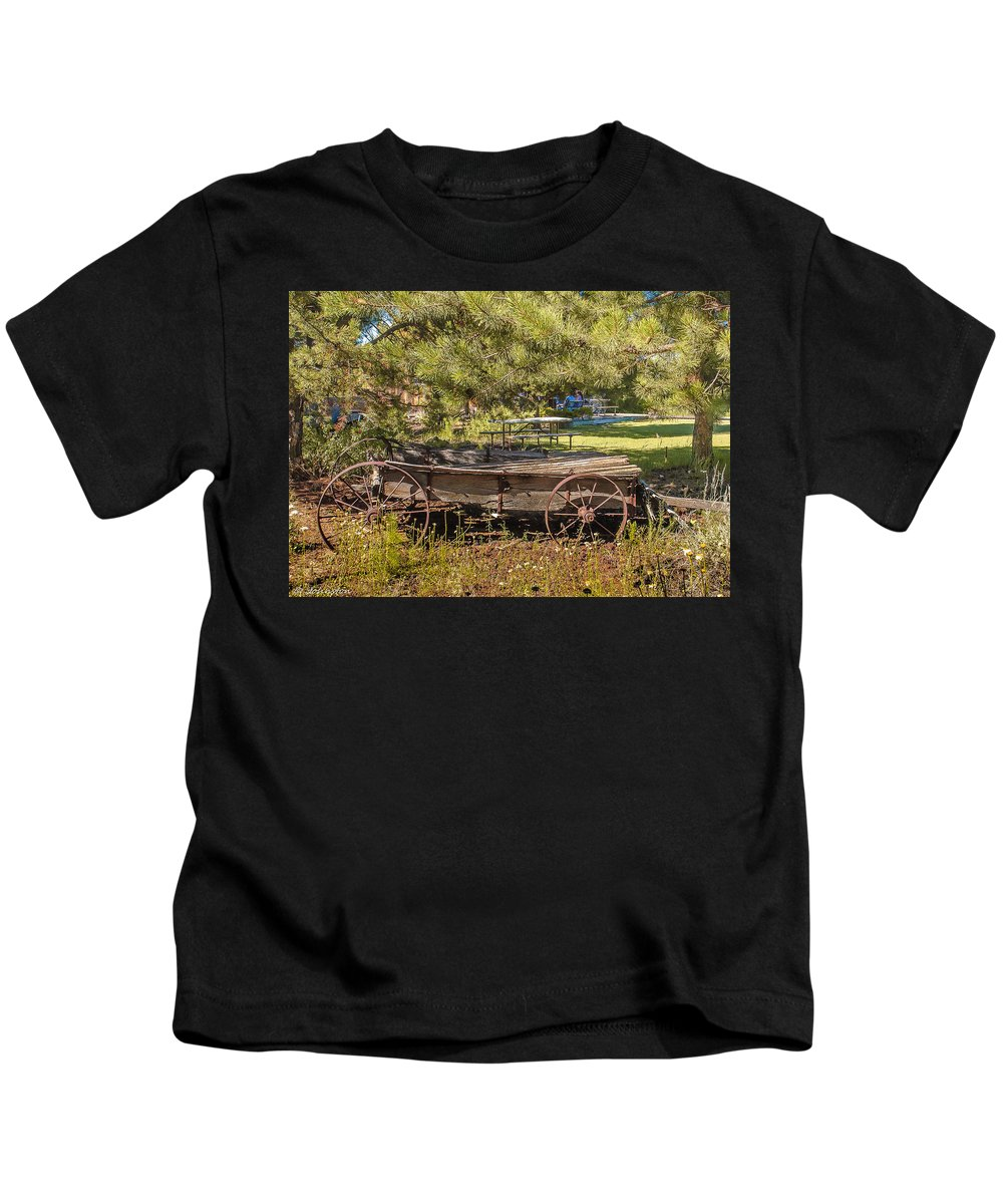 Agriculture Kids T-Shirt featuring the photograph Retired Wagon At Thousand Trails by Bob and Nadine Johnston