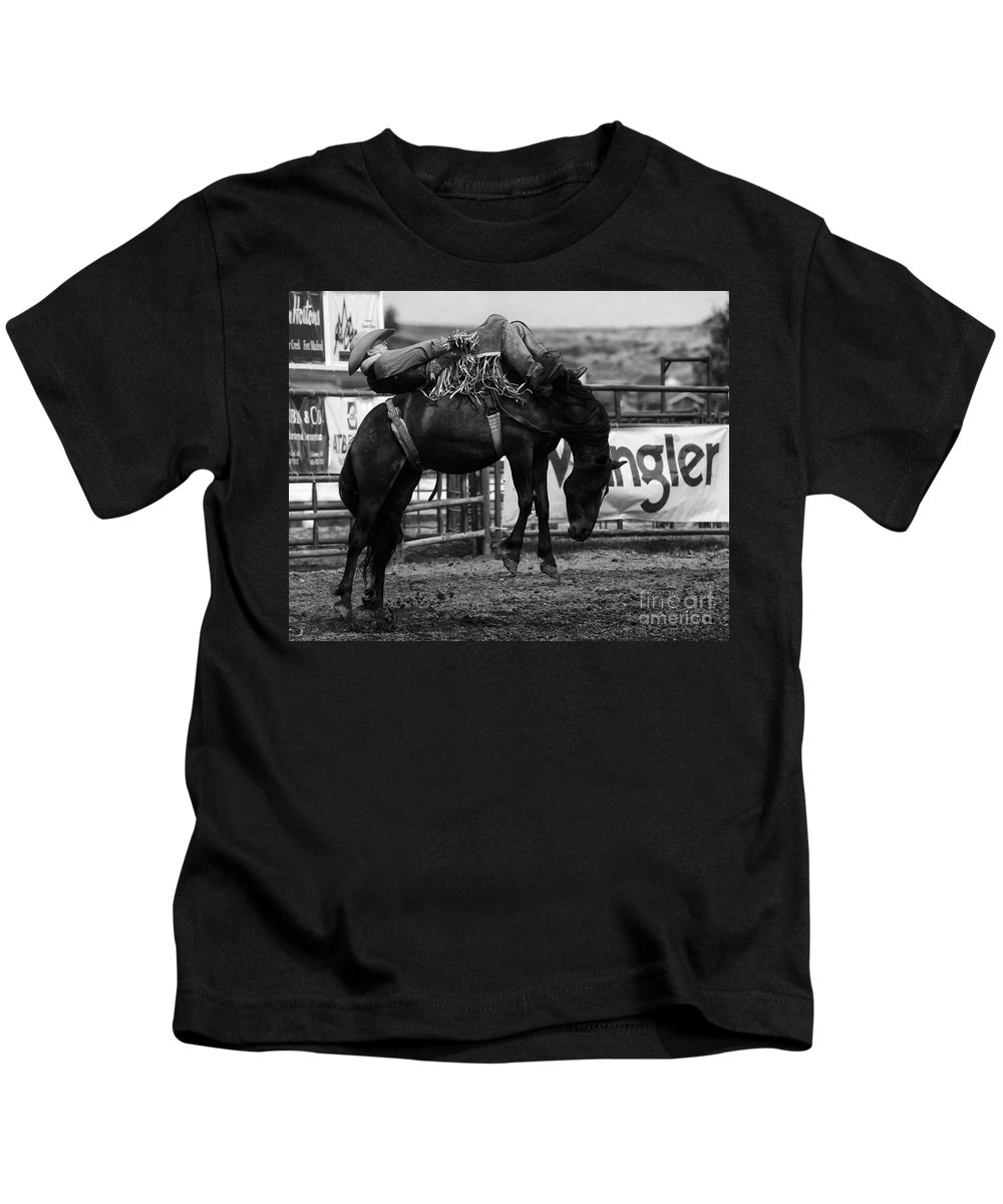 Horse Riding Kids T-Shirt featuring the photograph Rodeo Power Of Conviction by Bob Christopher
