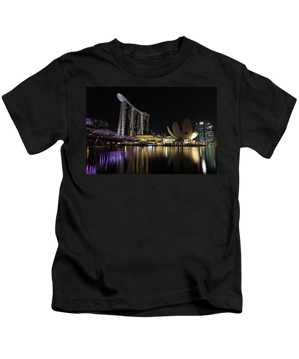 Artscience Kids T-Shirt featuring the photograph Helix Bridge To Marina Bay Sands by Paul Fell