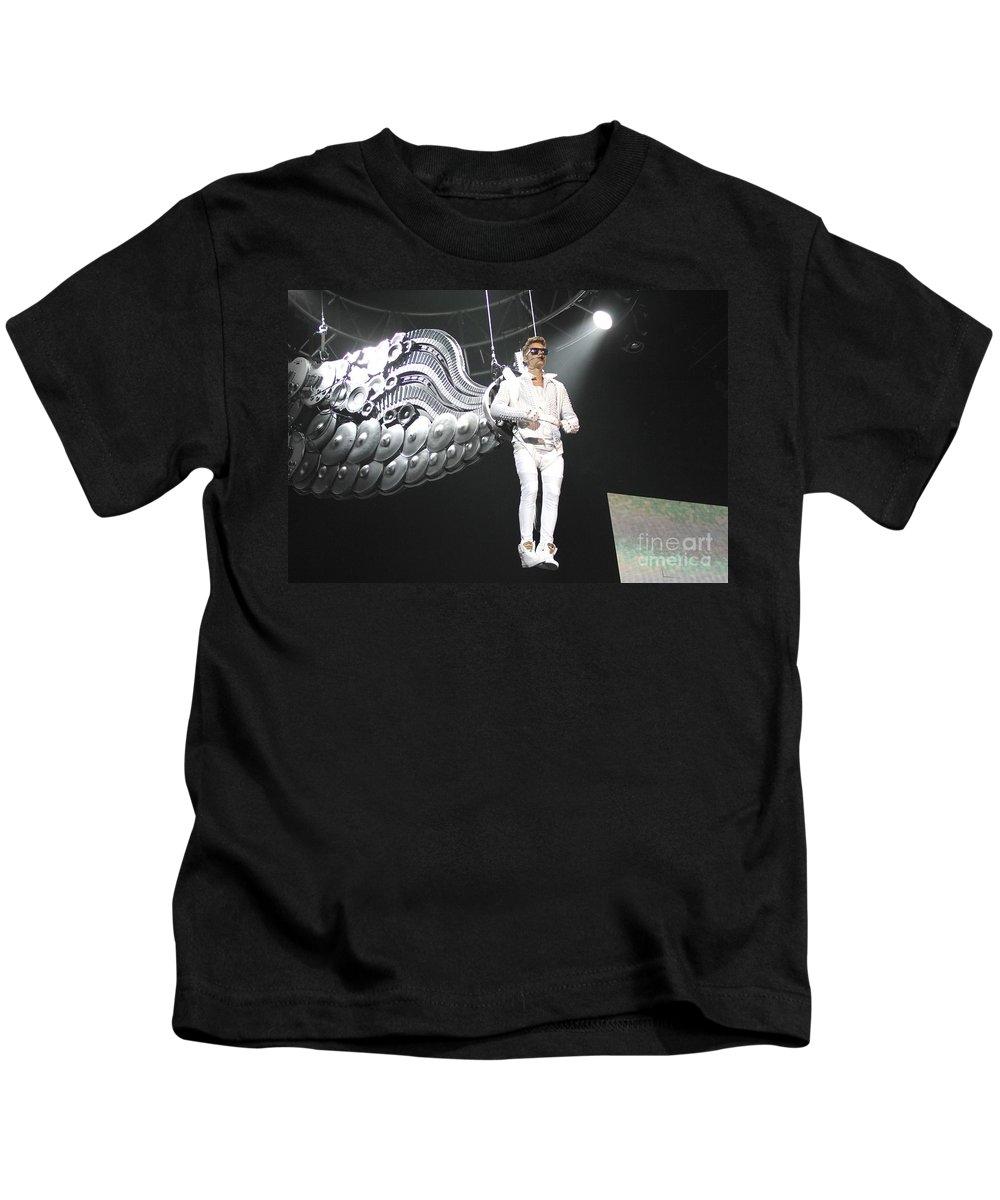 Singer Kids T-Shirt featuring the photograph Singer Justin Bieber by Concert Photos