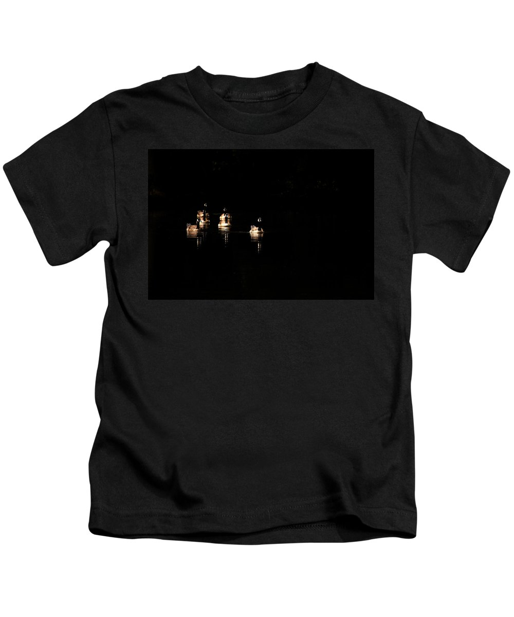 Canada Goose Kids T-Shirt featuring the photograph Six Geese A Swimming by Karol Livote