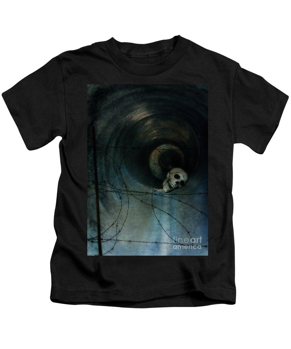 Skull Kids T-Shirt featuring the photograph Skull In Drainpipe by Jill Battaglia