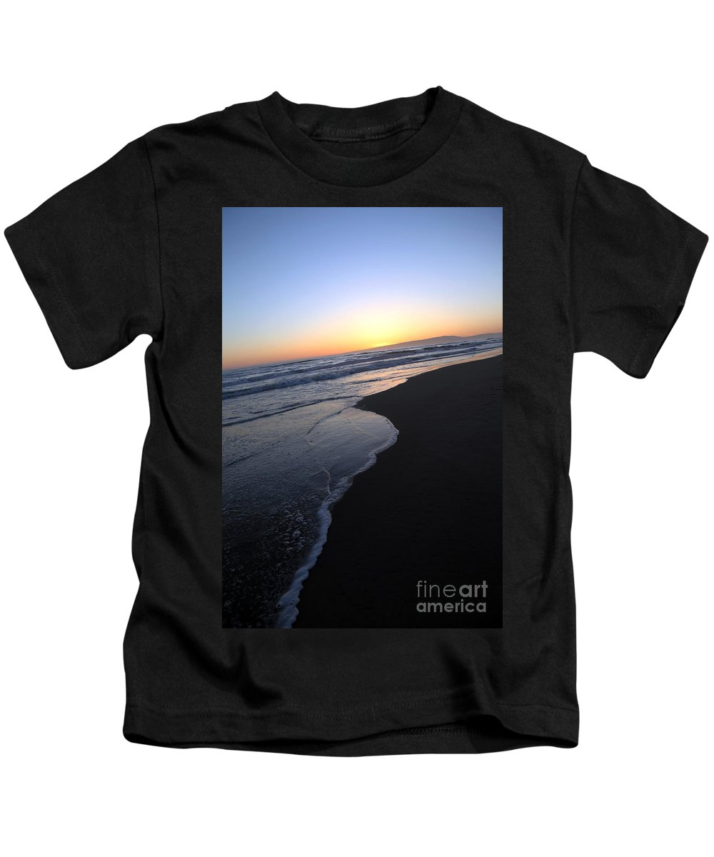 sunset Beach Kids T-Shirt featuring the photograph Sliding Down - Sunset Beach California by Amanda Barcon