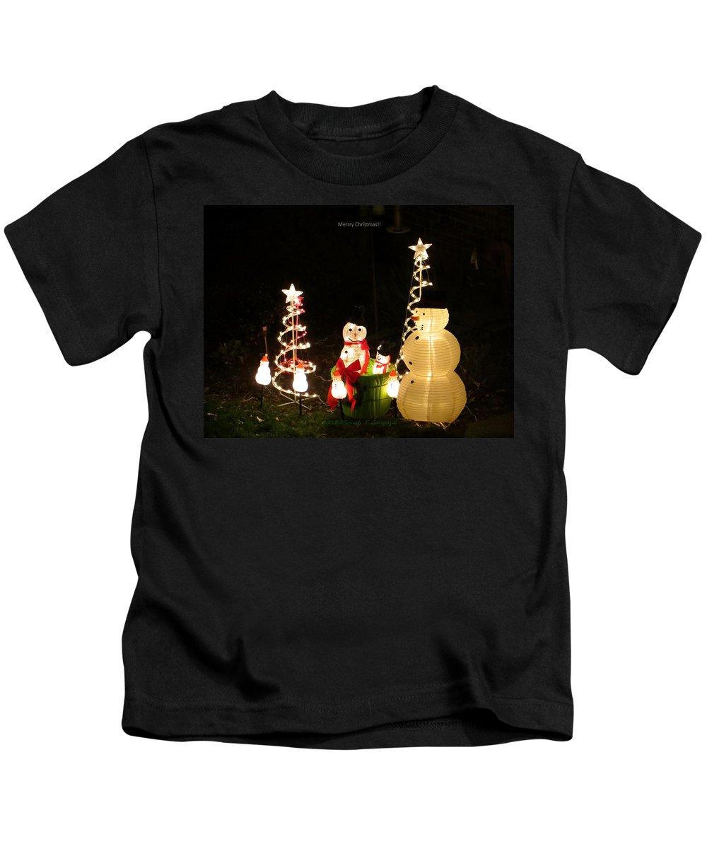 Snowman Kids T-Shirt featuring the photograph Snowman Celebrates Christmas by Sonali Gangane