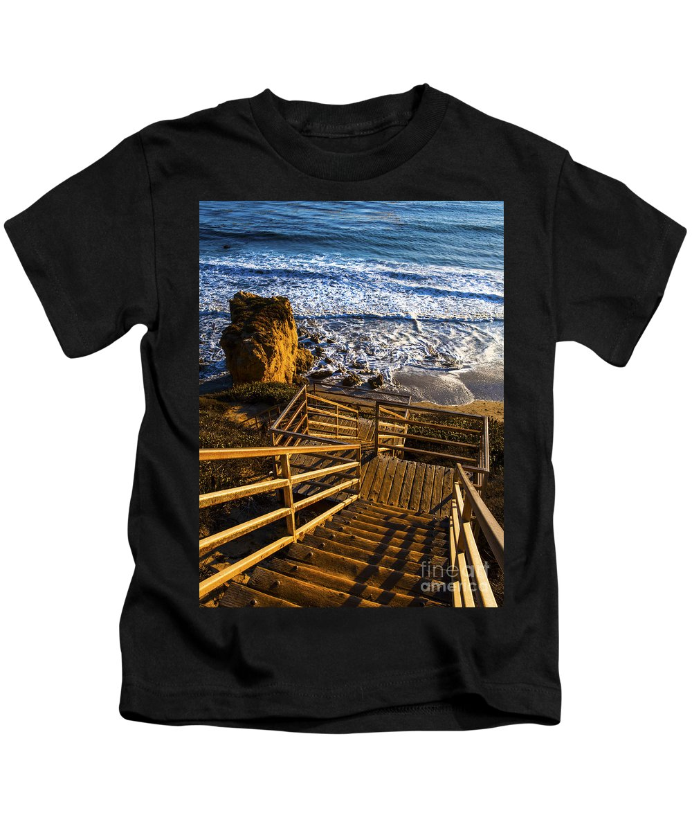Steps To Blue Ocean Waves Photography Kids T-Shirt featuring the photograph Steps To Blue Ocean And Rocky Beach by Jerry Cowart